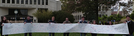 AU Students with Simchat Torah scroll.