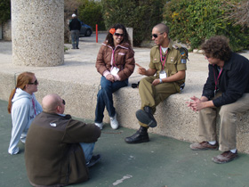 Diaspora students meet with an Israeli soldier.