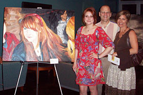 Amanda Smith and her parents with her oil on canvas piece entitled In Red.