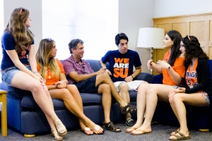 Hillel President Wayne Firestone, third form left, speaking with Syracuse University student outreach leaders at the Hillel Institute, hosted by Washington University in St. Louis, August 2012.