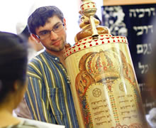 Student carries Torah.