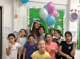 Emma with students on bday 3