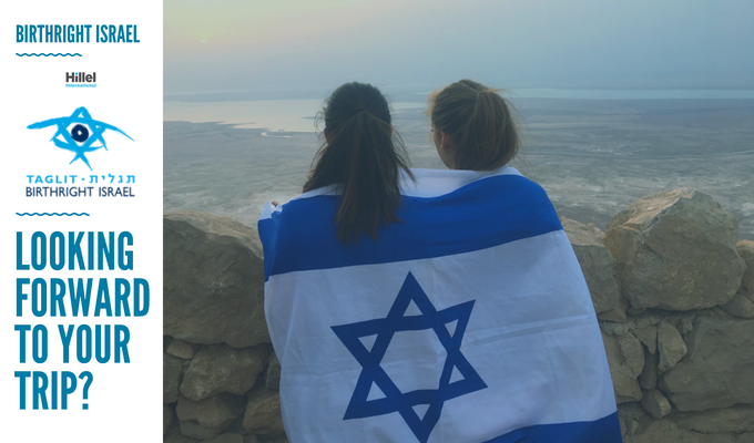 """Looking forward to your trip? Birthright Israel with Hillel"" with image of two girls draped in Israeli flag on top of Masada"
