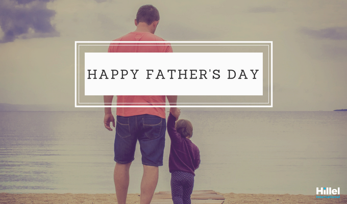 """Happy Father's Day"" with a photo of a father holding his son's hand"