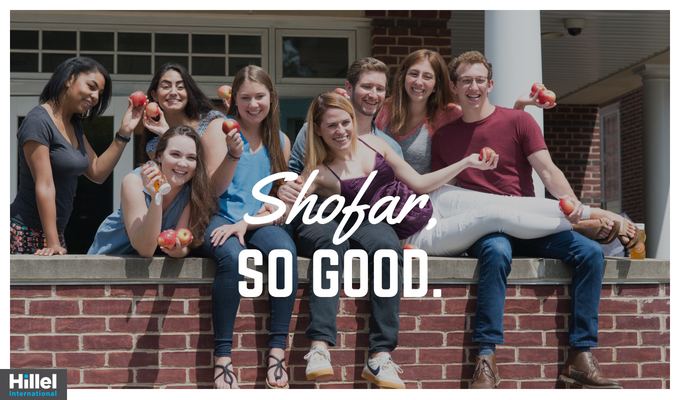 """Shofar, so good."" with image of students holding up apples"