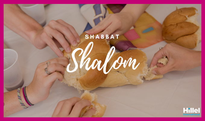 """Shabbat Shalom"" with photo of hands on Challah"
