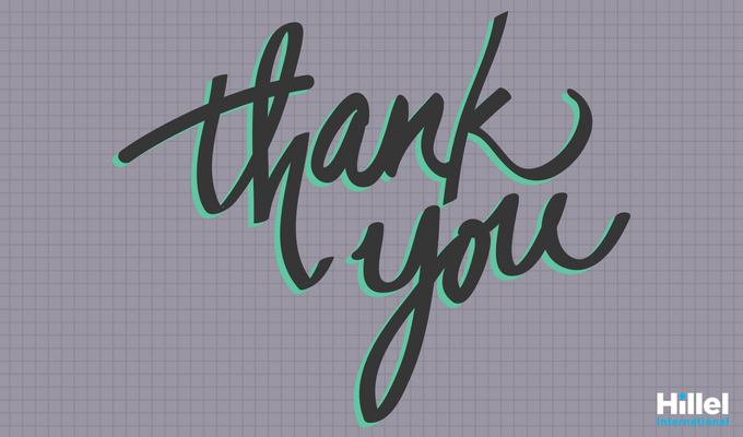 """Thank you"" in cursive on dark grey, graph paper background"