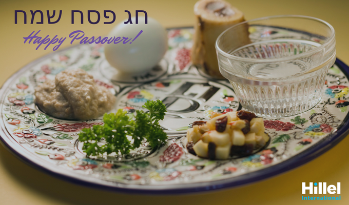 "Seder plate with the text ""Happy Passover"" and ""Hag Pesach Sameach"" in Hebrew."