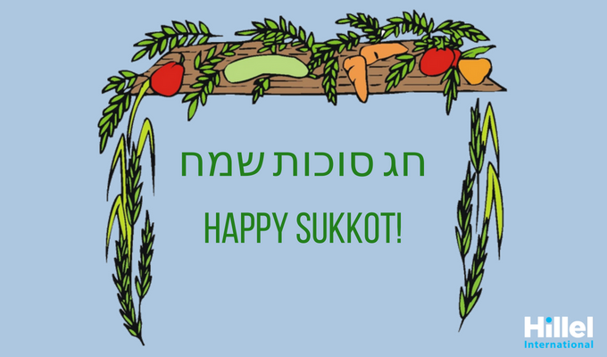 Hag Sukkot Sameach written in Hebrew on a blue background with an image of a Sukkah.