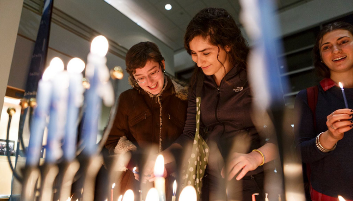 Students lighting Hanukkah candles