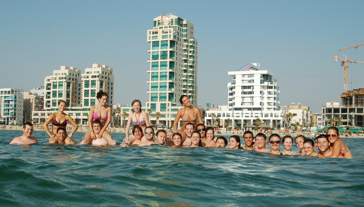 Students enjoying the beach in Tel Aviv