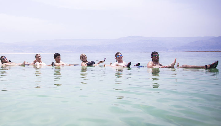 Birthright students floating in the Dead Sea.
